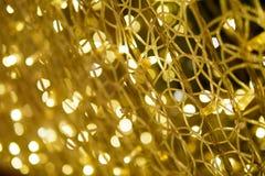 Fondo leggero astratto del bokeh dell'oro nel partito e nel celebratio Immagini Stock Libere da Diritti