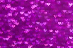 Fondo ligero abstracto Defocused de los corazones púrpuras Fotografía de archivo libre de regalías