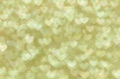 Fondo ligero de los corazones abstractos Defocused del oro Foto de archivo libre de regalías