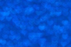 Fondo ligero de los corazones azules abstractos Defocused Imagen de archivo libre de regalías