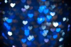 Fondo ligero de los corazones azules abstractos Defocused Foto de archivo