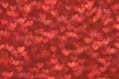 Fondo ligero de los corazones rojos abstractos Defocused Imagen de archivo