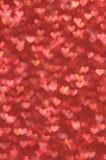 Fondo ligero de los corazones rojos abstractos Defocused Foto de archivo libre de regalías