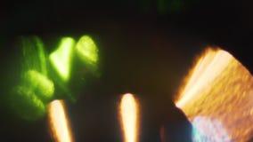 Fondo ligero orgánico impresionante del escape Porciones de bokeh caliente, de diversos tonos y de colores metrajes