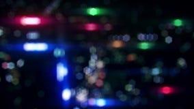 Fondo loopable vago variopinto di moto delle luci notturne della città stock footage