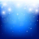 Fondo luminoso del invierno de copos de nieve Imágenes de archivo libres de regalías