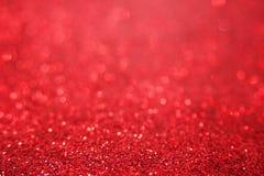 Fondo luminoso rosso del bokeh di scintillio Struttura della scintilla Fotografia Stock
