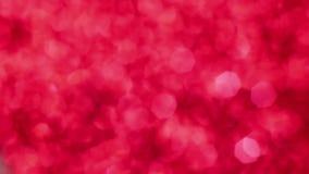Fondo magico delle luci del bokeh di Buon Natale rosso Walpaper felice di giorno di biglietti di S. Valentino di fascino stock footage