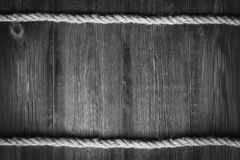 Fondo marrón de madera con la cuerda Fotografía de archivo