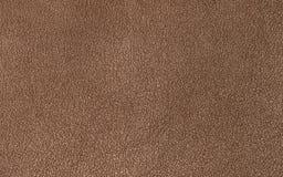 Fondo marrón de cuero o material texturizado cuero Fotografía de archivo libre de regalías