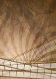 Fondo marrón del extracto de la tira de película del Grunge Fotografía de archivo