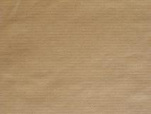 Fondo marrone chiaro della superficie della carta Fotografia Stock Libera da Diritti