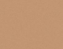 Fondo marrone chiaro di struttura del primo piano del cartone della carta del mestiere fotografia stock