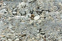 Fondo meraviglioso di calcestruzzo grigio con una pietra strutturata sul fondamento immagine stock