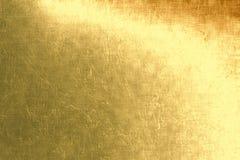 Fondo metálico del oro, hoja, textura de lino, fondo festivo brillante Fotografía de archivo libre de regalías