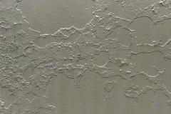 Fondo metallico grigio con sbucciatura e pittura incrinata Fotografia Stock