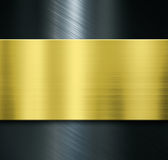 Fondo metallico nero eccessivo di piastra metallica dell'oro Fotografia Stock