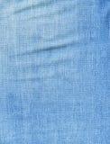 Fondo misero di struttura delle blue jeans Fotografia Stock