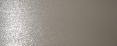 Fondo monocromático metálico de plata, colocado horizontalmente gradiente fotografía de archivo libre de regalías