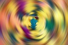 Fondo multicolore astratto con i cerchi e la lucentezza scintillanti Fondo radiale astratto della sfuocatura Fotografia Stock Libera da Diritti