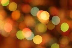 Fondo multicolore festivo con effetto del bokeh Fotografie Stock