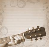 Fondo musical con la guitarra Fotografía de archivo libre de regalías