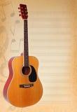 Fondo musical con la guitarra Imagen de archivo