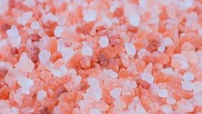 Fondo natural del movimiento de la sal Himalayan rosada cristalina metrajes