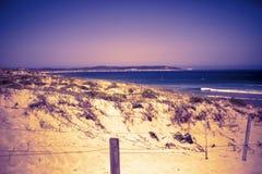 Fondo natural del paisaje Opinión de la arena Las dunas de la costa varan la opinión del mar imagen de archivo