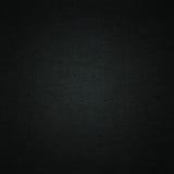 Fondo negro de la materia textil Fotografía de archivo
