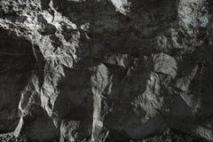 Fondo negro de la piedra de la pared fotografía de archivo libre de regalías