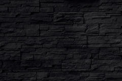 Fondo negro de pared de piedra Imagenes de archivo