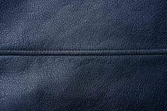 Fondo negro de un pedazo de cuero de la ropa fotos de archivo libres de regalías