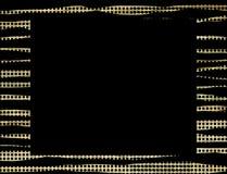 Fondo negro del marco de los puntos del oro Foto de archivo libre de regalías