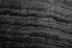 Fondo negro natural de pared de piedra o fondo de la textura para adentro Foto de archivo libre de regalías