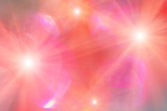 Fondo nei colori rossi e rosa con le luci brillanti Fotografie Stock Libere da Diritti