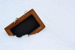 Fondo nero del bordo con neve sull'inverno Fotografia Stock Libera da Diritti
