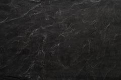 Fondo nero del piatto della pietra dell'ardesia fotografia stock libera da diritti