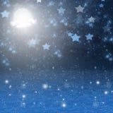 Fondo nevoso de la noche de la Navidad Foto de archivo libre de regalías