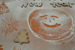Fondo - nuovo anno, biscotti di zucchero in polvere Fotografia Stock