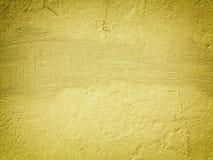 Fondo o struttura giallo della parete della pittura Fotografia Stock Libera da Diritti