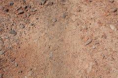 Fondo o struttura rosso della sporcizia (suolo) fotografie stock