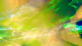 Fondo olografico iridescente della stagnola dell'estratto confuso video d archivio