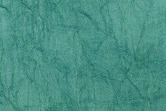 Fondo ondulado de la perla verde clara de un material de materia textil Tela con el primer natural de la textura Imagen de archivo