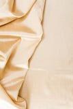 Fondo ondulato dorato del tessuto Fotografie Stock Libere da Diritti