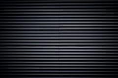 Fondo ondulato nero di struttura del metallo fotografia stock