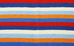 Fondo orizzontale a strisce del panno tricottato. Immagine Stock