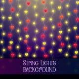 Fondo oscuro con las luces decorativas de la secuencia Guirnaldas brillantes brillantes de las bombillas fotos de archivo