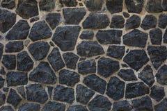 Fondo oscuro de pared de piedra Fotos de archivo