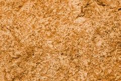 Fondo oscuro del extracto de la textura de la pared del color del Cheddar Imágenes de archivo libres de regalías